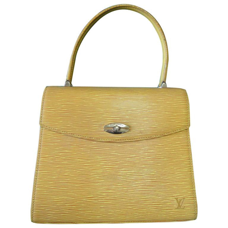 86fe6c2337ae Vintage Louis Vuitton yellow epi Malesherbes handbag. Classic purse for  Spring and summer season.