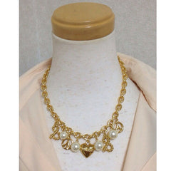 MINT. Vintage Moschino thick chain statement necklace with golden heart, peace mark, and big faux pearl balls.