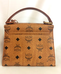 Vintage MCM classic brown monogram mini kelly bag with key, designed by Michael Cromer. Rare and beautiful masterpiece.