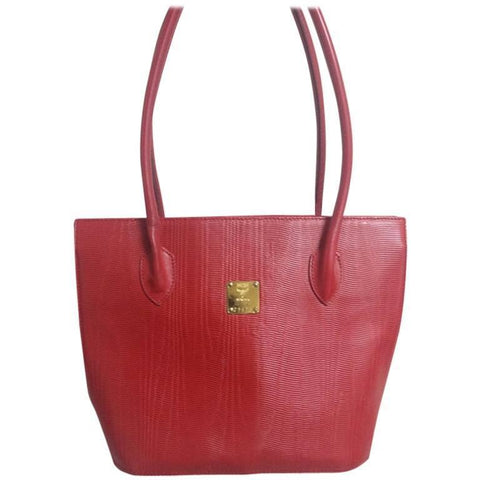 Vintage MCM red lizard embossed leather tote bag with monogram jacquard interior and golden square logo plate. Designed by Michael Cromer