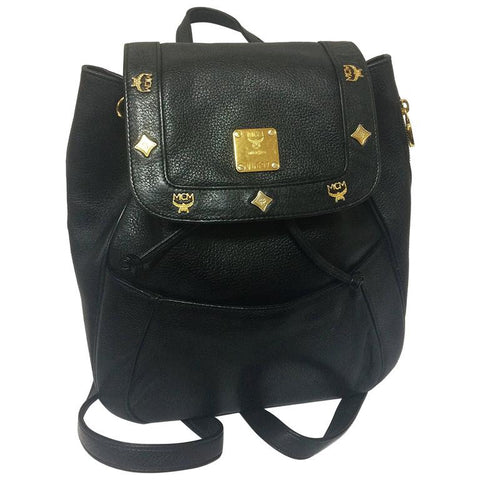 80's vintage MCM genuine leather black backpack with gold tone hardware and charms. Designed by Michael Cromer. Unisex bag for daily use.