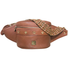 Vintage MCM brown leather fanny pack with multiple layer golden chain and leather belt with logo studded motifs. Rare masterpiece.