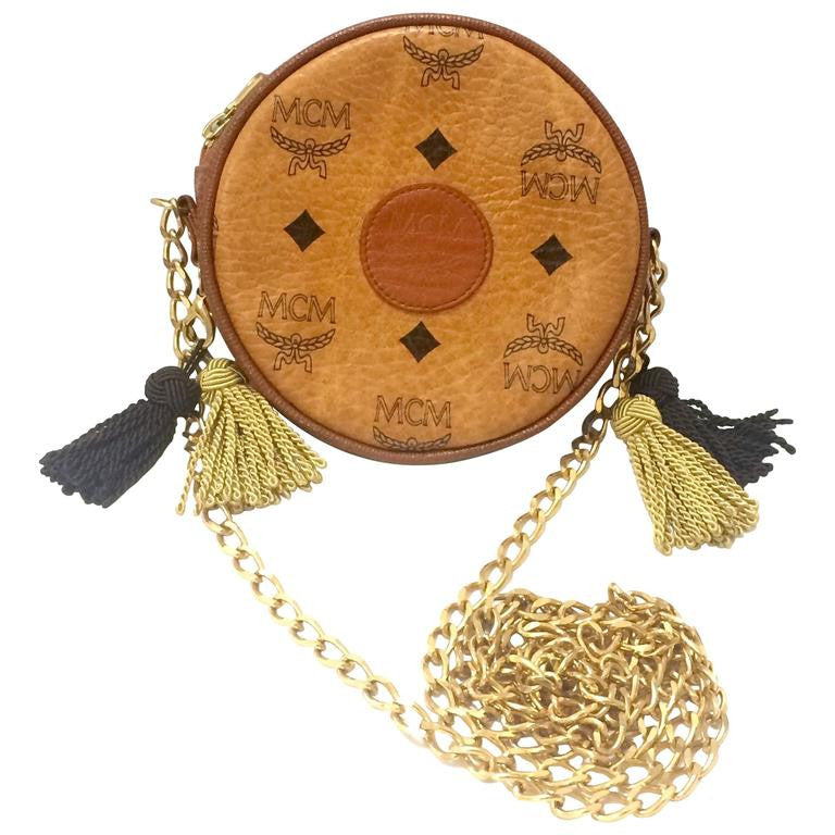 MINT. Vintage MCM brown monogram round shape mini chain shoulder purse with brown and  beige fringes. Designed by Michael Cromer. Suzy Wong. Made in West Germany
