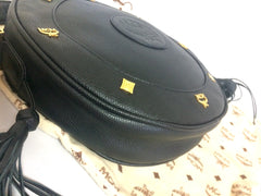 MINT. Vintage MCM black grained leather round shoulder bag with golden logo studs and fringes. Designed by Michael Cromer. Suzy Wong