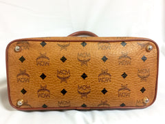 Vintage MCM classic brown monogram handbag in bolide design. Classic bag designed by Michael Cromer. Handmade in Germany