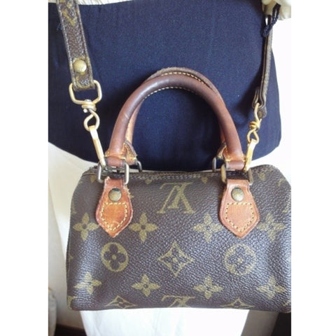 SOLD OUT: 70s-80s Vintage Louis Vuitton rare mini Speedy bag. Very chic and mod.