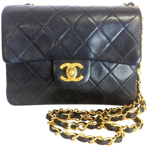 90's vintage CHANEL black lamb leather flap chain shoulder bag, classic 2.55 mini purse with gold tone CC closure.