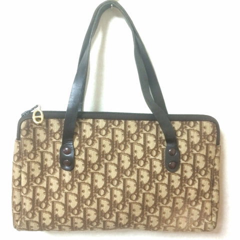 Vintage Christian Dior brown trotter jacquard mini handbag with leather handles.