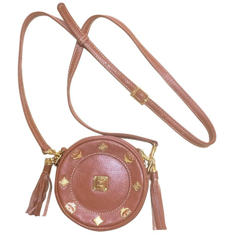 Vintage MCM brown leather round mini Suzy Wong shoulder bag with golden logo motifs. trimmings. Designed by Michael Cromer.