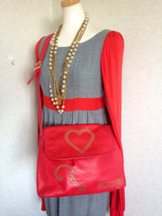 Vintage MOSCHINO red leather messenger shoulder bag with question mark, heart and logo golden studs. Too cute to carry.