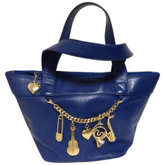 Vintage Moschino navy blue leather classic tote bag with golden cute dangling charms. Masterpiece jewel bag
