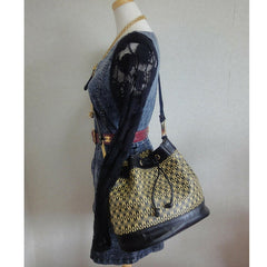 Vintage MOSCHINO black and ivory logo print hobo bucket shoulder bag with leather trimmings and golden M charms.