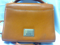 Vintage MOSCHINO orange brown grained leather kelly handbag with a detachable shoulder strap and golden heart shape logo charm.