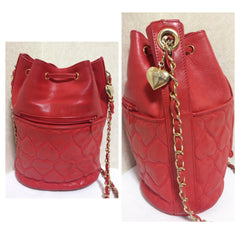 Vintage MOSCHINO red heart shape quilted lambskin shoulder hobo bucket purse with chain straps. Too cute to carry.