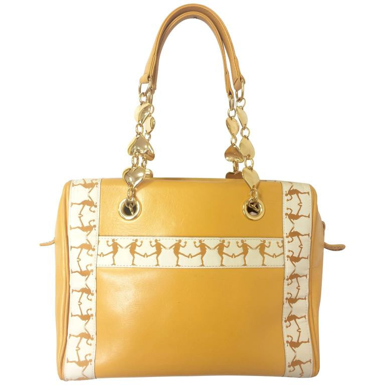 Vintage MOSCHINO yellow leather handbag purse with golden heart motif chains and dancing girl motifs. Too cute to carry.