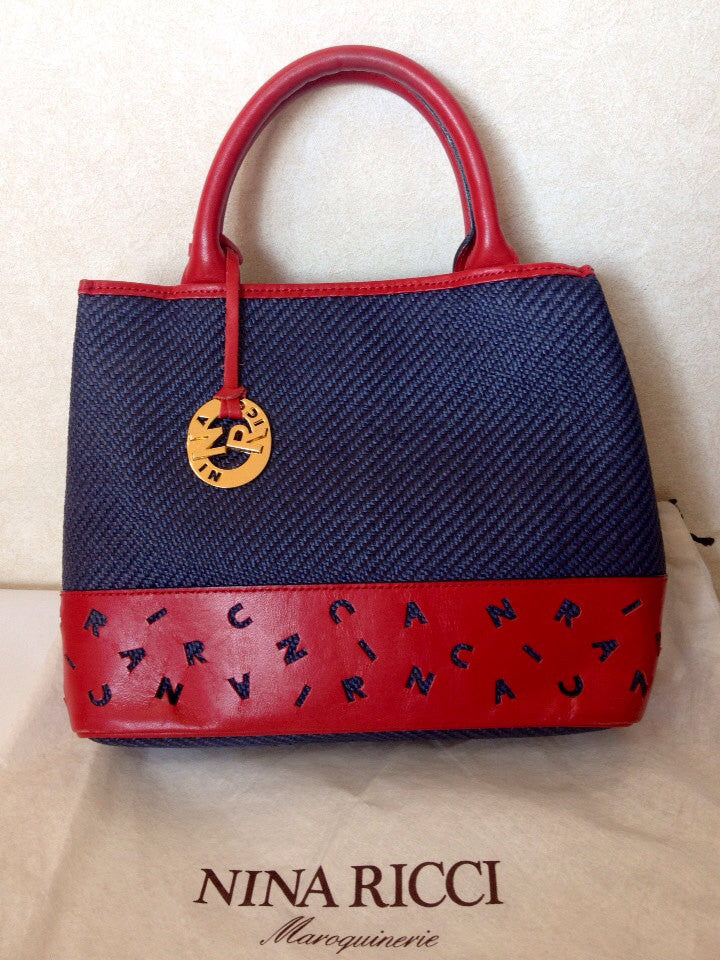 Vintage Nina Ricci navy woven straw and red leather mix handbag, tote bag with golden logo charm. Mod and chic daily purse.