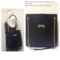 Vintage Nina Ricci black tote bag with golden chain straps with golden logo bow, ribbon shape motif. Perfect daily purse