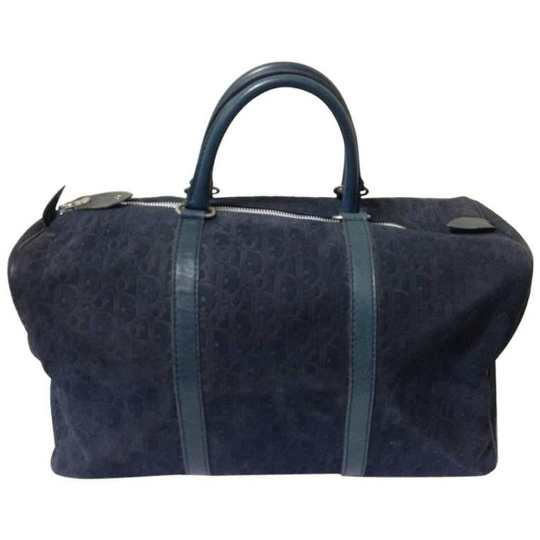 80's vintage Christian Dior Bagages navy genuine suede leather travel duffle bag, purse, handbag with embossed Dior logo allover. Unisex