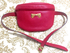 "MINT. Vintage Nina Ricci red grained leather waist purse, fanny pack, clutch bag with logo bow motif. So chic. 32.2"" through 37""(82-94cm)."