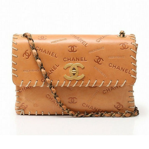 Vintage CHANEL tan brown allover logo embossed leather jumbo, large 2.55 shoulder bag with large stitches and bronze color chains. Rare bag