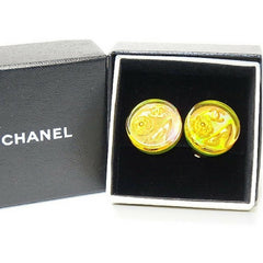 Vintage CHANEL orange aurora earrings with Chanel iconic charms. Shoe, camellia, and CC mark in it. Perfect.