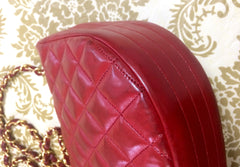 Vintage CHANEL rare red lambskin oval flap 2.55 shoulder bag with golden large CC motif and chain straps.  Masterpiece.