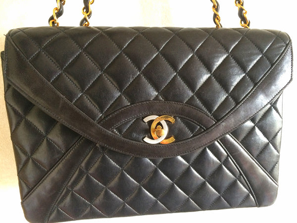 67b972b54de1 ... Vintage Chanel black 2.55 classic oval stitch design flap bag with gold  and silver CC and ...