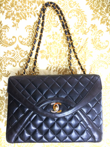 Vintage Chanel black 2.55 classic oval stitch design flap bag with gold and  silver CC and 7435d79e40310