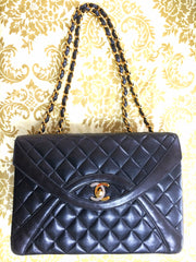Vintage Chanel black 2.55 classic oval stitch design flap bag with gold and silver CC and gold chains. Paris limited edition. Rare purse