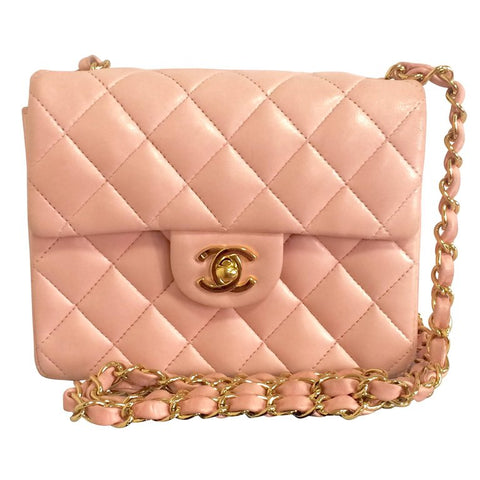 Vintage CHANEL milky pink lamb leather flap chain shoulder bag, classic 2.55 mini purse with gold tone CC closure.