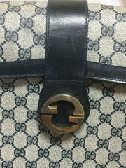 Vintage Gucci navy monogram postman shoulder purse with golden GG closure and adjustable shoulder stap. Unisex bag