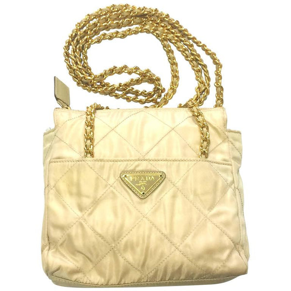 a36d2ba2d90a5c Vintage Prada quilted nylon ivory beige shoulder bag with gold tone chain  handles.