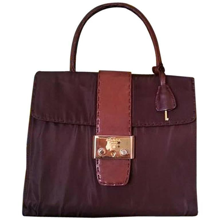 57f9511995f Vintage Prada brown leather and dark brown nylon combo handbag with golden  hardware closure. One