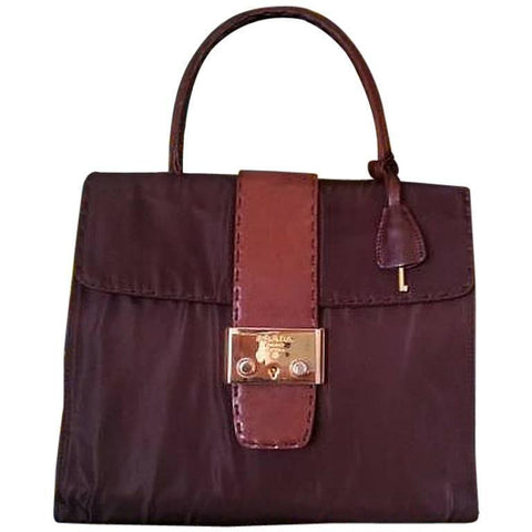 Vintage Prada brown leather and dark brown nylon combo handbag with golden hardware closure. One of the rarest purse from PRADA.