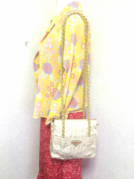 cbf7b9c8e813 Must have Vintage Prada quilted nylon ivory beige shoulder bag with gold  tone chain handles. Must have