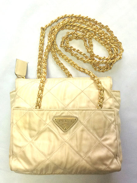 35918a7ea53 Must have Vintage Prada quilted nylon ivory beige shoulder bag with gold  tone chain handles.