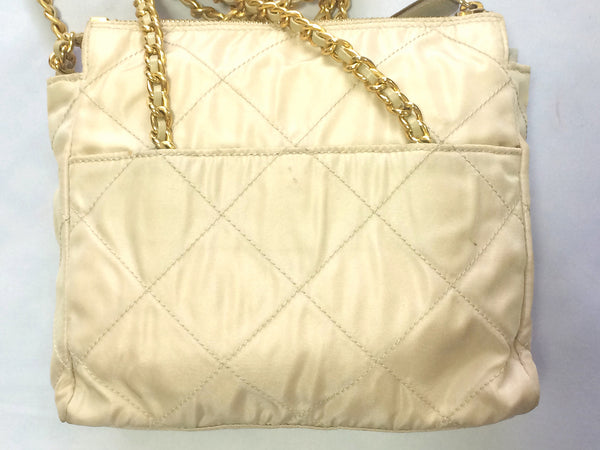 798ad44d4b74 Must have Vintage Prada quilted nylon ivory beige shoulder bag with gold  tone chain handles.