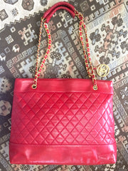 Vintage CHANEL red lambskin large tote bag with gold tone chains and CC mark charm to the LAMPO zipper. Classic purse