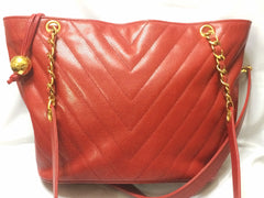 Vintage CHANEL red caviarskin v stitch, chevron style chain shoulder tote bag with golden CC ball charm. Classic purse for daily use.