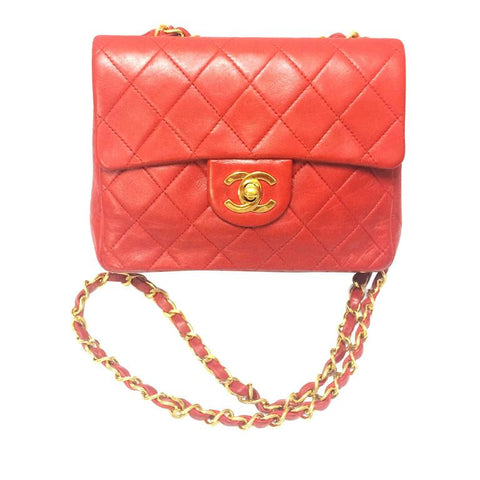 Vintage CHANEL lipstick red lambskin purse with golden CC and chain strap. Classic mini 2.55 Chanel red bag back in the era.