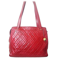 Vintage CHANEL deep red color classic quilted lamb leather tote bag with golden CC ball charm. Large size purse for daily use.