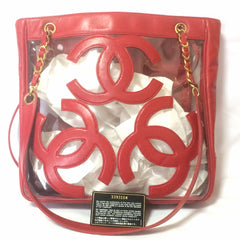 Vintage CHANEL clear vinyl and red leather combination shoulder purse, tote with CC marks and matching pouch. Golden chain.