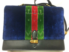 80's Vintage Roberta di Camerino red, navy, and green ribbon velvet shoulder purse with golden R motif closure. Classic bag