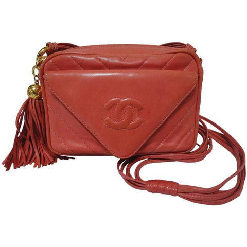 Vintage CHANEL rare color, salmon pink lambskin 2.55 camera style shoulder purse with large CC featured flap and a fringe. Chevron stitch