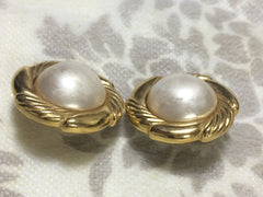 Vintage CHANEL golden round faux pearl earrings in flower design frame. Classic and simple earrings.