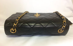Vintage CHANEL black lamb leather 2.55 classic square shape shoulder bag with golden CC and chain strap. Elegant purse