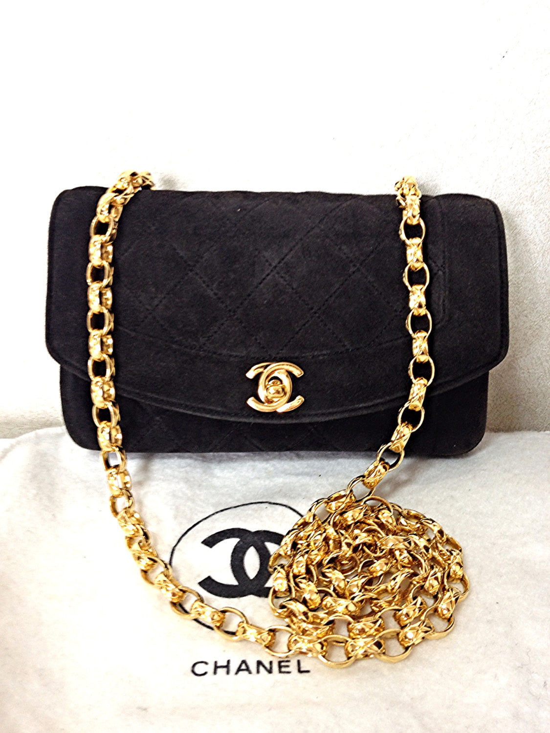 Vintage CHANEL charcoal black suede leather classic 2.55 shoulder purse with gold tone chain straps. Must have daily purse