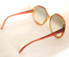 1960s. 70s. Vintage COBRA large, round oversized orange frame sunglasses with grey shades. OPTYL.