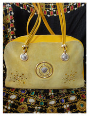 Vintage rare Gianni Versace yellow suede and leather duffle speedy style purse with golden medusa and sunburst charms. Lady Gaga style.