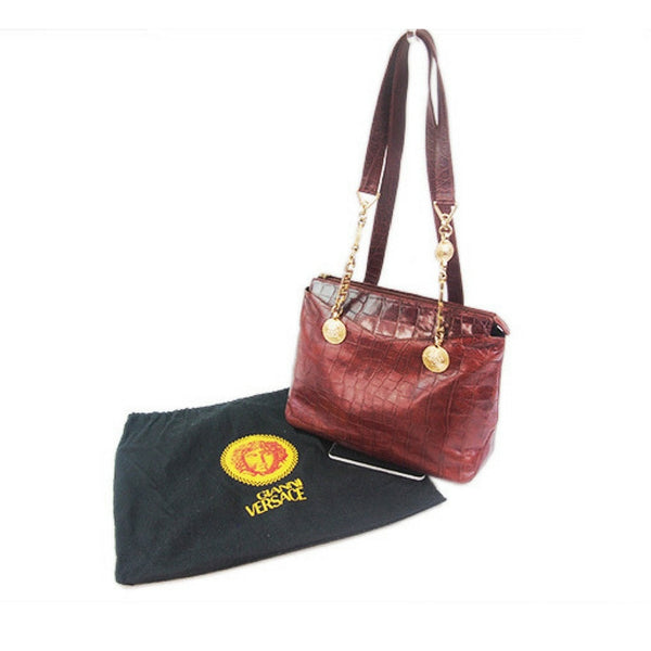 214f23c9 Vintage Gianni Versace brown croc-embossed leather shoulder tote bag with  golden hardware and medusa charms.